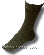 Colour: Olive or Black-Sizes: One size fits UK 6-11 -Fibre Content: 65% Pure New Wool, 35% Nylon - Features: Wool rich for warmth. Strategic cushion sole for comfort, ribbed leg & upper foot, turnover top- Ideal for: Military, Rambling, Adventure